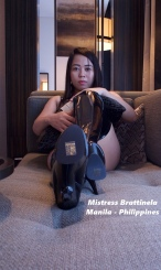 mistress brat wearing latex boots